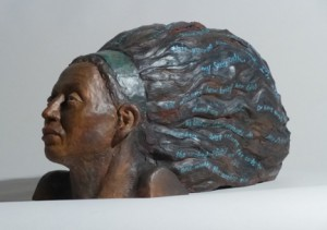 Sandy Frank sculpture woman's head streaming hair lines from poem The Seer by Tania Pryputniewicz