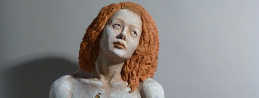 Sandy Frank sculpture red haired woman with monarch detail and poem Someone