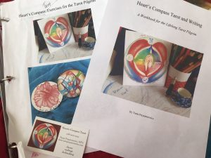 Heart's Compass Tarot and Writing Workbook Cover, colored pencils and heart's candle with compass points
