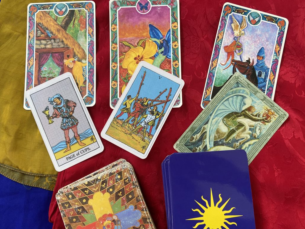 Page of Cups, Five of Wands, Knight of Cups