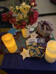 """candles, flower bouquet, """"wish"""" star, """"believe"""" star, Rider Waite Smith tarot deck"""