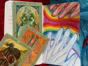 One blue hand reaching towards a red hand over a mirror rainbow sky, Art Card Ten of Wands, Knight of Disks.